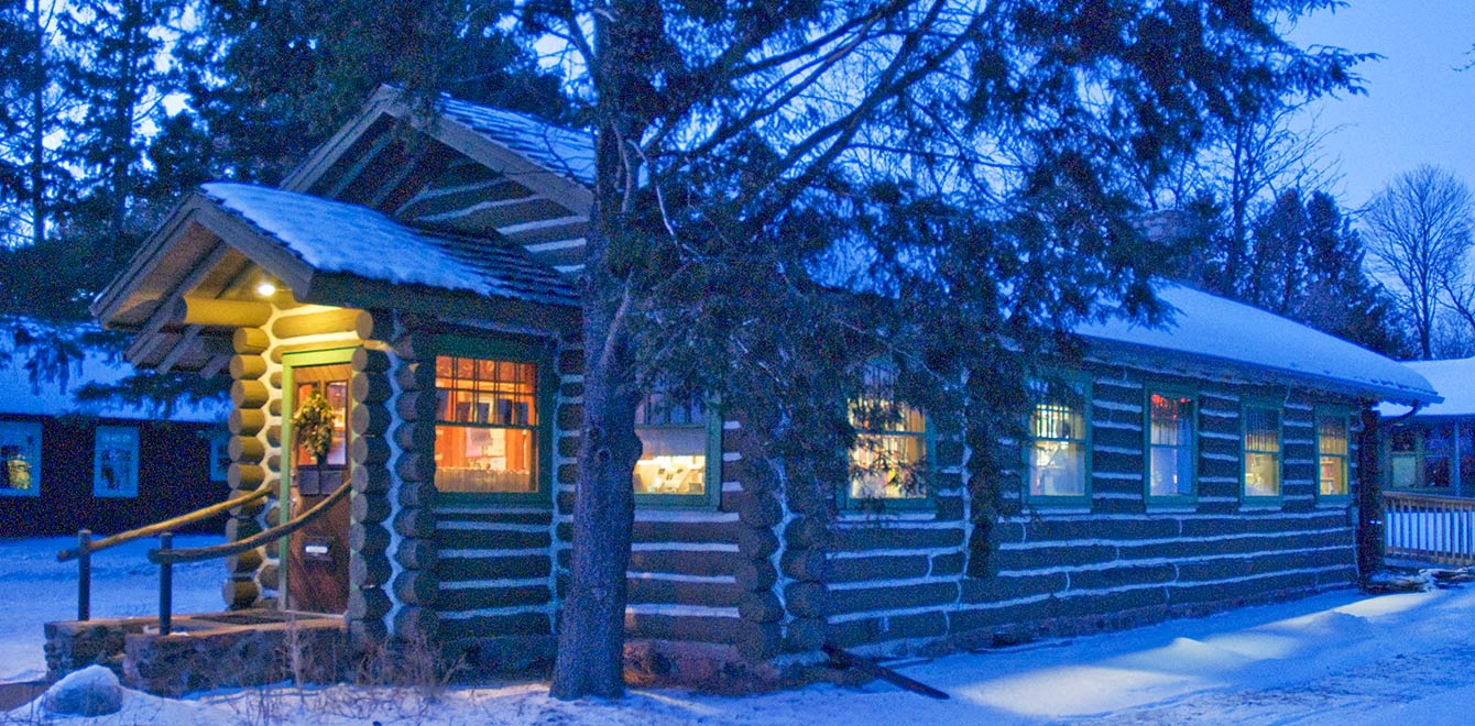 A twilight winter view of The Forest Lodge Library in Cable, Wisconsin.